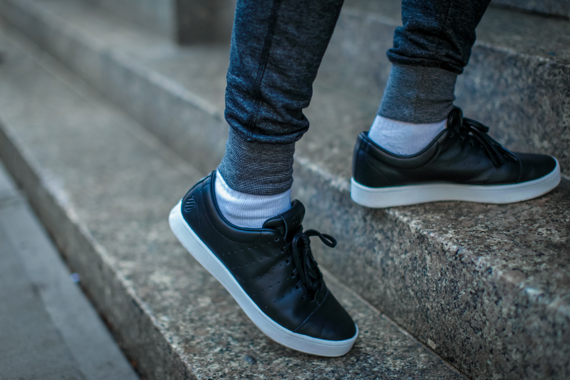 black sneakers with a white sole